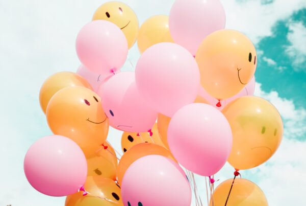 smiley faces on balloons