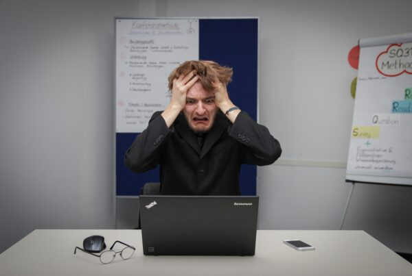man frustrated at computer issues
